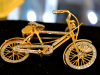 18kt gold with diamonds bicycle pendant.