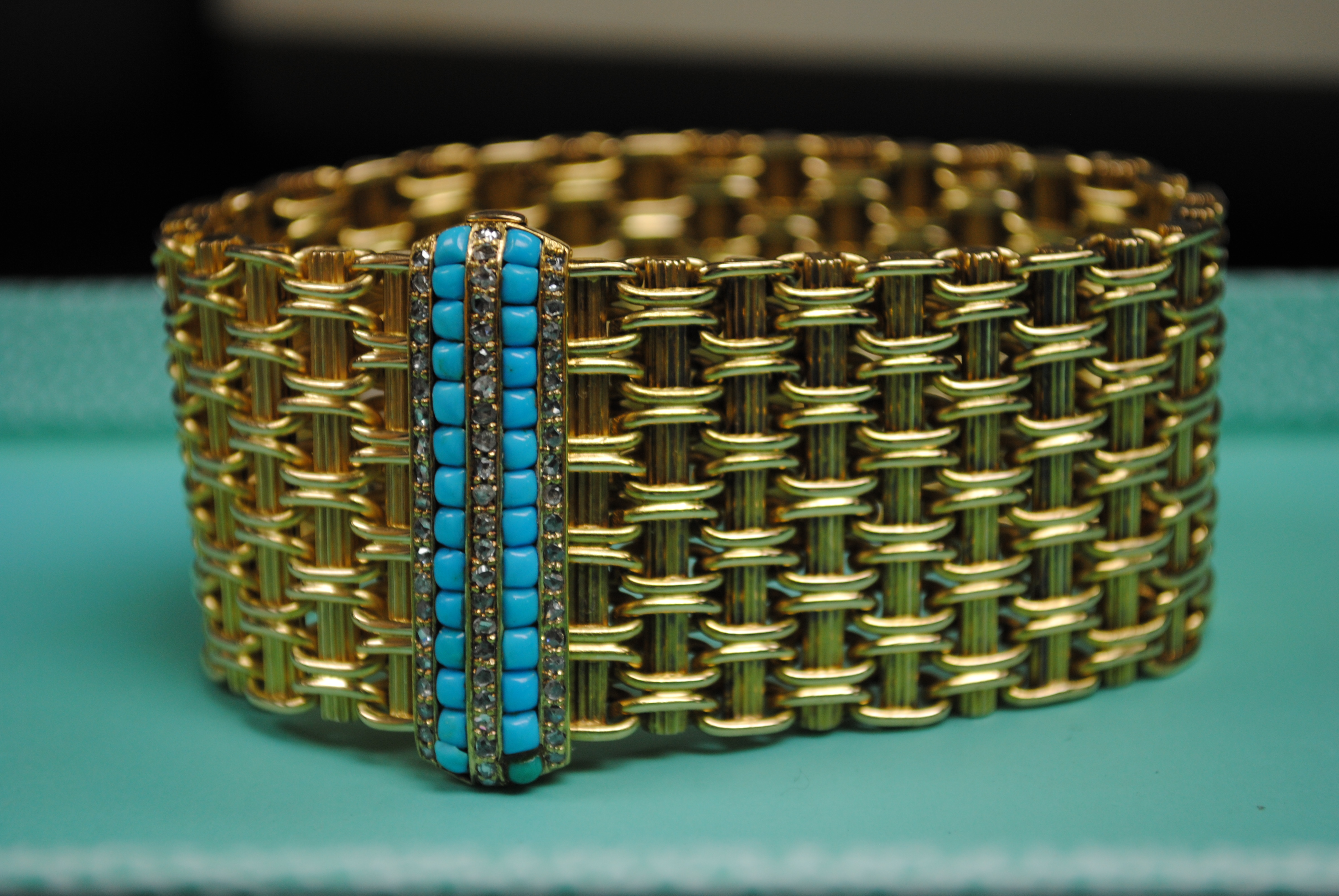 This 18kt estate bracelet may sink you to the bottom of the ocean, but who could resist turquoise for a beach cocktail party?