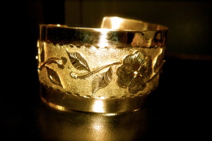 Stunning 14kt gold cuff with etched background and flower detail