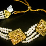 "Nothing says ""avant-garde"" like a 22kt gold and pearl choker!"