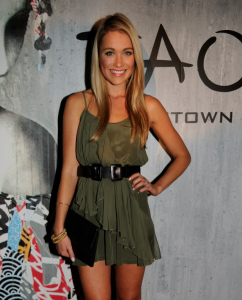 Katrina Bowden with a gorgeous stack of what appears to be 18kt gold bangles (Photo Credit:  Seth Browarnik/WorldRedEye)
