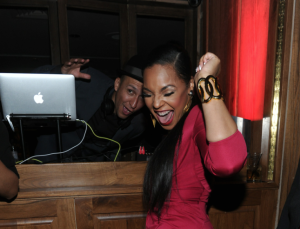 Dancing with the DJ, Ashtanti throws up a nice looking gold cuff as she gets down.