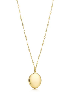 I love the detail in the chain with the simplicity of the oval 18kt gold locket.  Found at Tiffany & Co