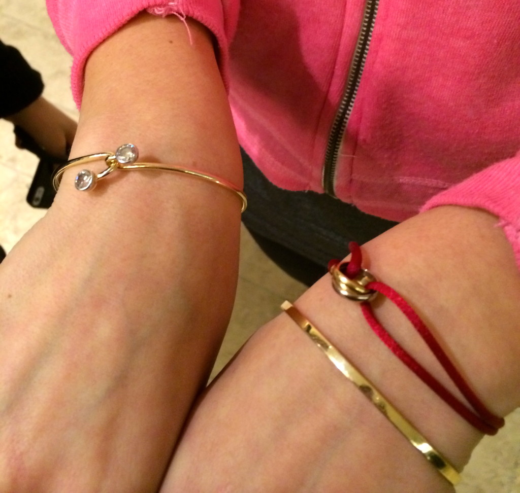 Even underneath her warm zip-up hoodie, my friend Paulene stacks her gold Cartier bracelets  with a vintage bypass bangle on her other hand.