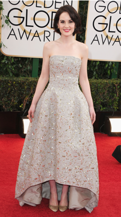 """Michelle Dockery dazzled in the seasons """"it"""" gold-tone- rose gold made by Bulgari.  Her look was very simple with diamond and gold flower earrings and a cocktail ring."""