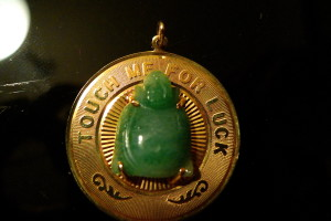 Buddha carved out of jade on a 14kt gold pendant