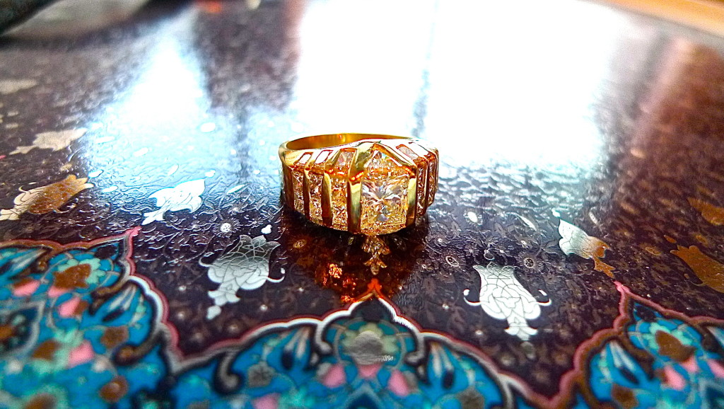 A more modern piece and appearing to be from the 90's, this ring has about 4.0 cts of diamonds and perfectly fits in a number of baguettes, princess cuts, and trillion cut diamonds.  Its construction leaves no part of the ring without beautiful adornment.